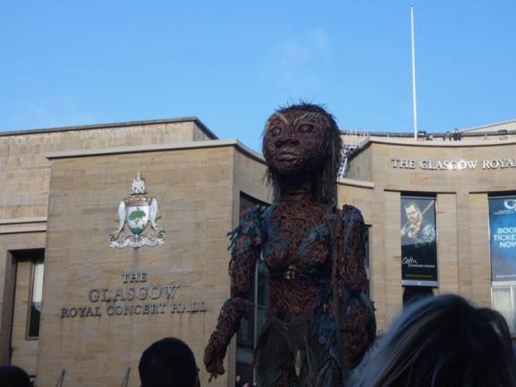 33 foot tall Puppet Storm heading through the streets of Glasgow